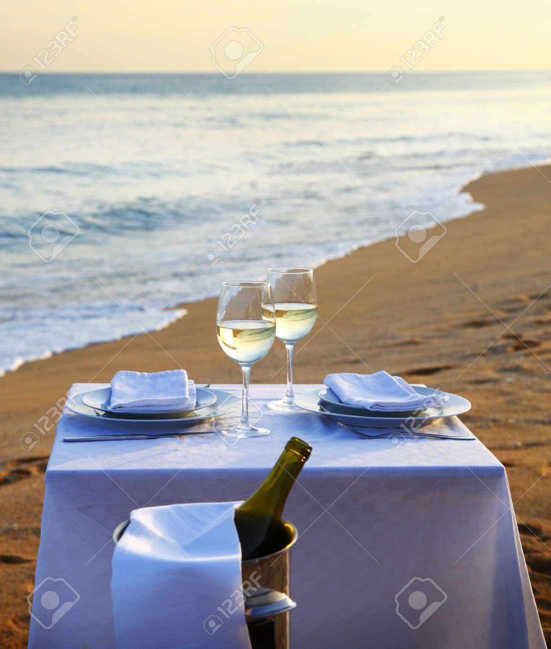 A restaurant table on a beach - 17333786