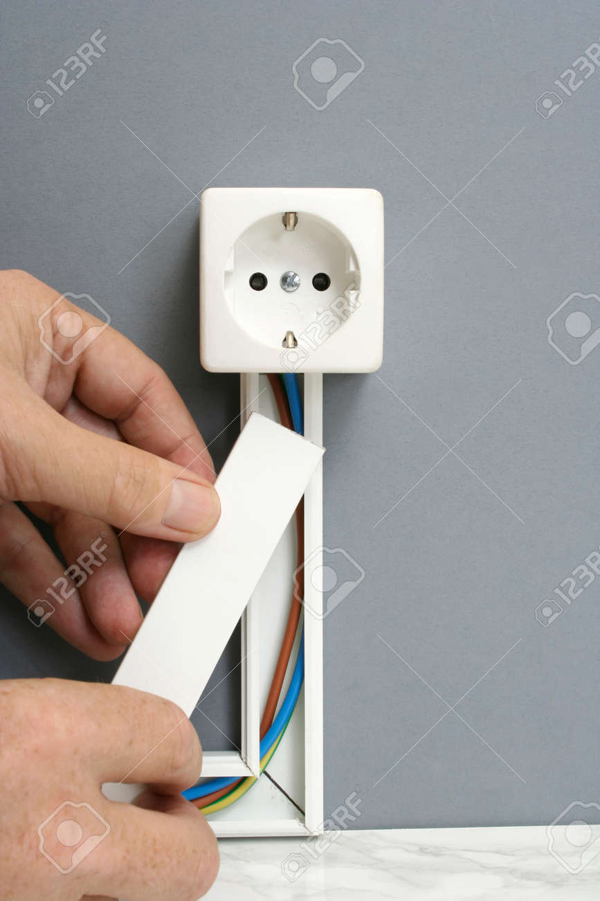 Installing A Power Outlet With Surface Mount Electric Wiring.. Stock ...