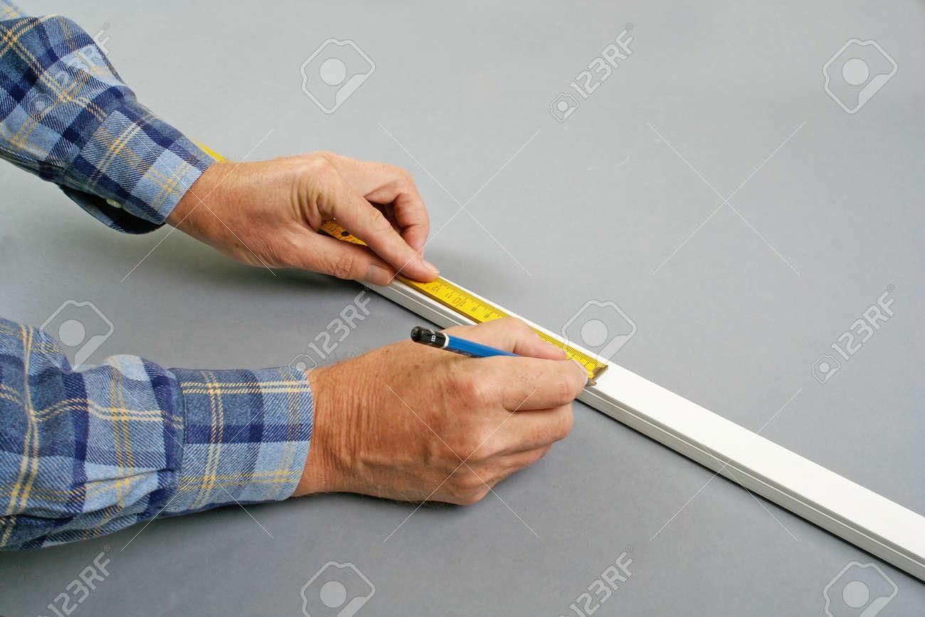 handyman measuring surface mount plastic electric wiring channel rh 123rf com Surface Mount Wiring Surface Mount Wiring Box PPT
