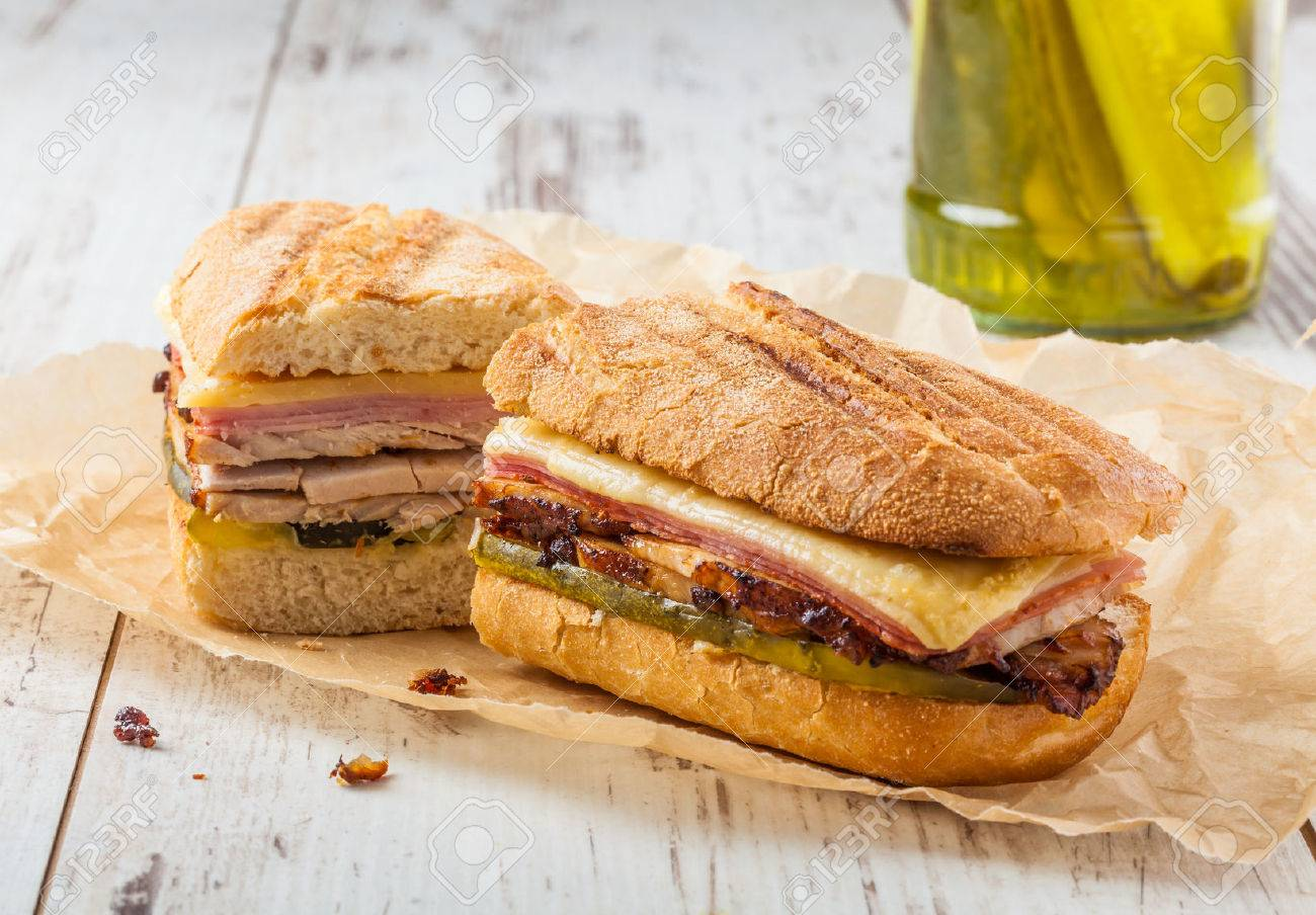 Cubanito. Traditional Cuban Sandwich with Ham, Pork and Cheese - 69218986