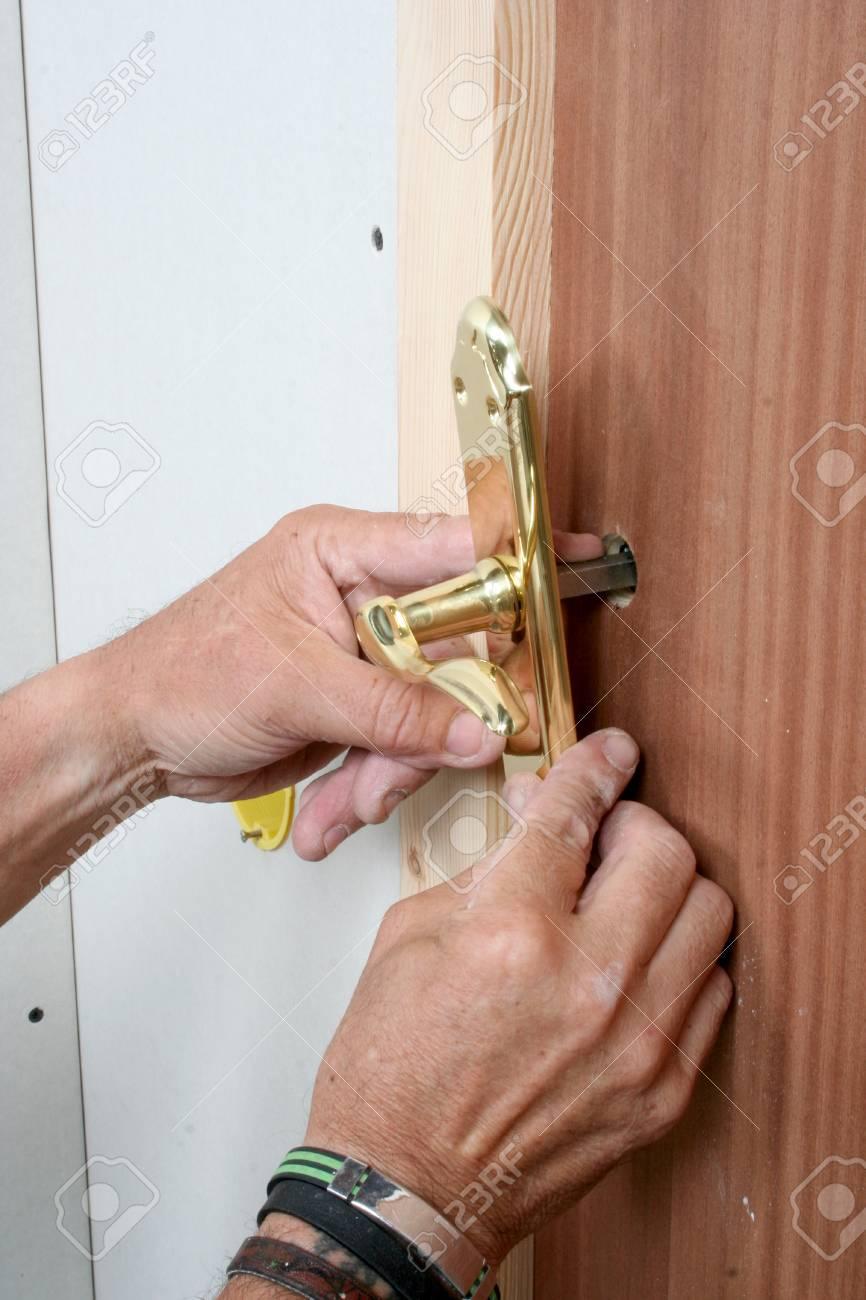 Handyman repairing a door handle Stock Photo - 94616031 & Handyman Repairing A Door Handle Stock Photo Picture And Royalty ...