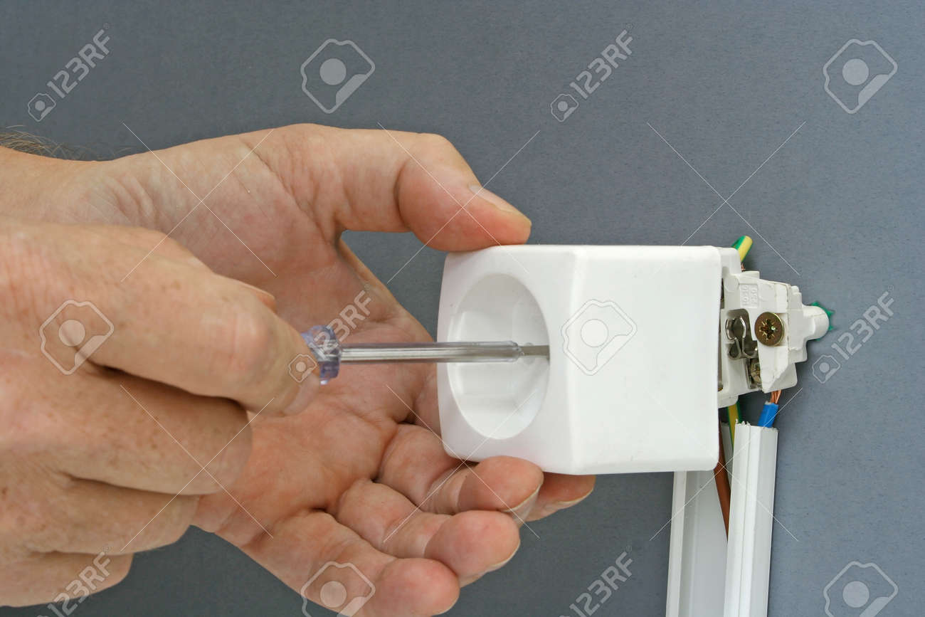 Installing A Power Outlet With Surface Mount Electric Wiring Stock Channel Photo 94616147