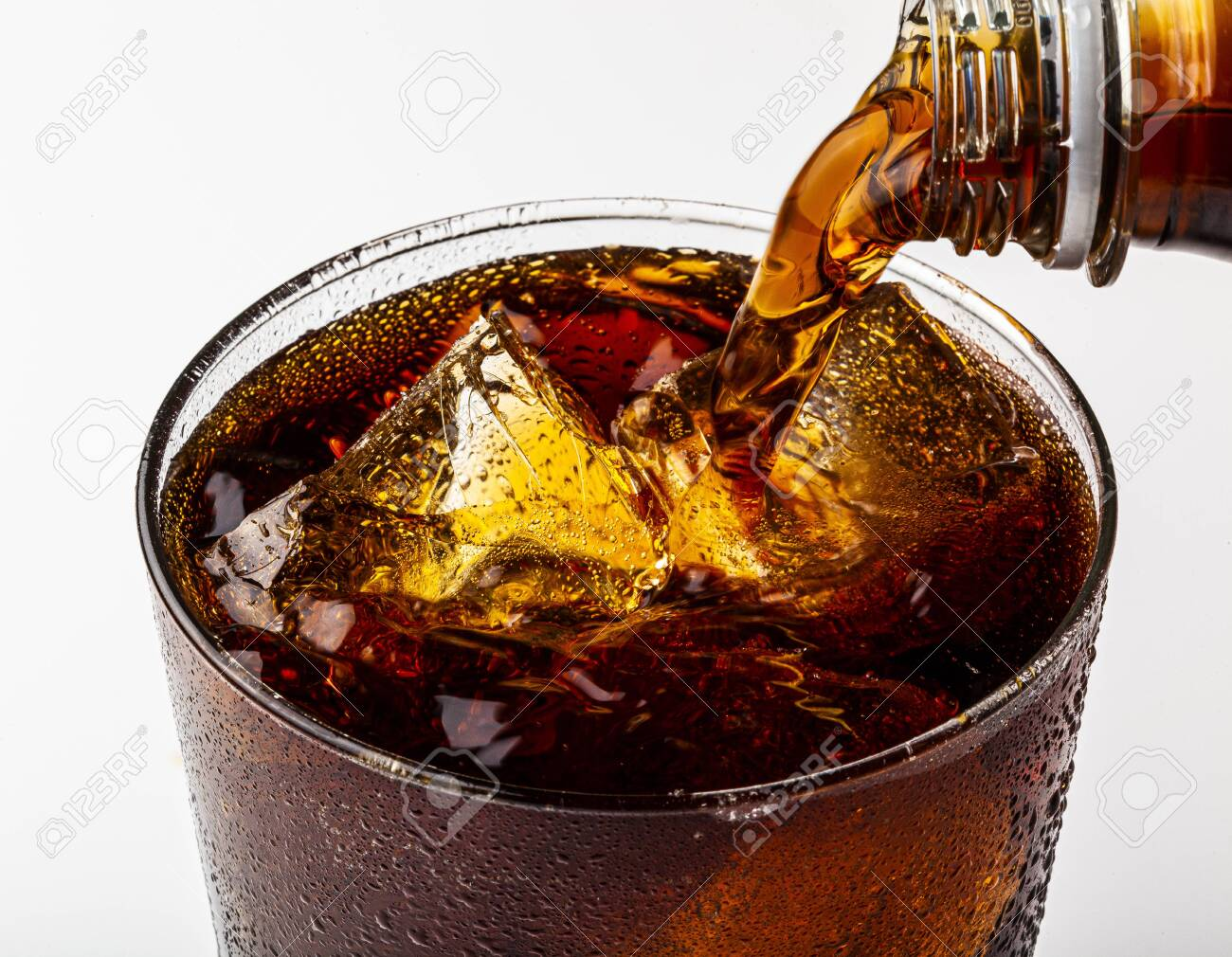 Ice cold refreshing carbonated summer drink with ice chunks in a glass. - 155549895