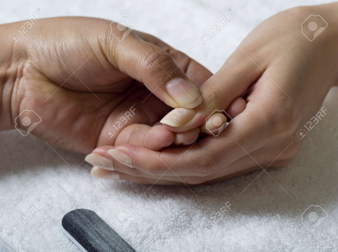 A Close Up Of Female Hands Doing Manicure, Applying Glue For.. Stock ...