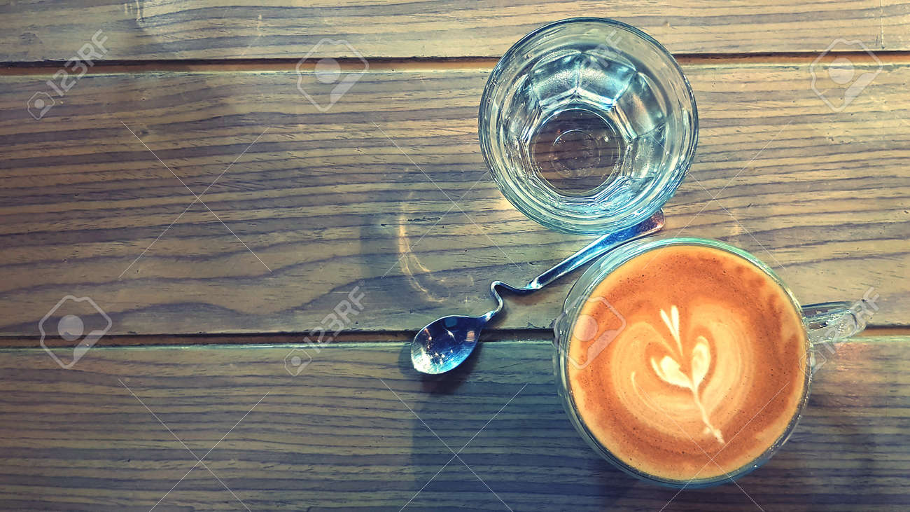 Top View Cup Of Hot Art Latte Coffee And Glass Of Water With Stock Photo Picture And Royalty Free Image Image 100459246