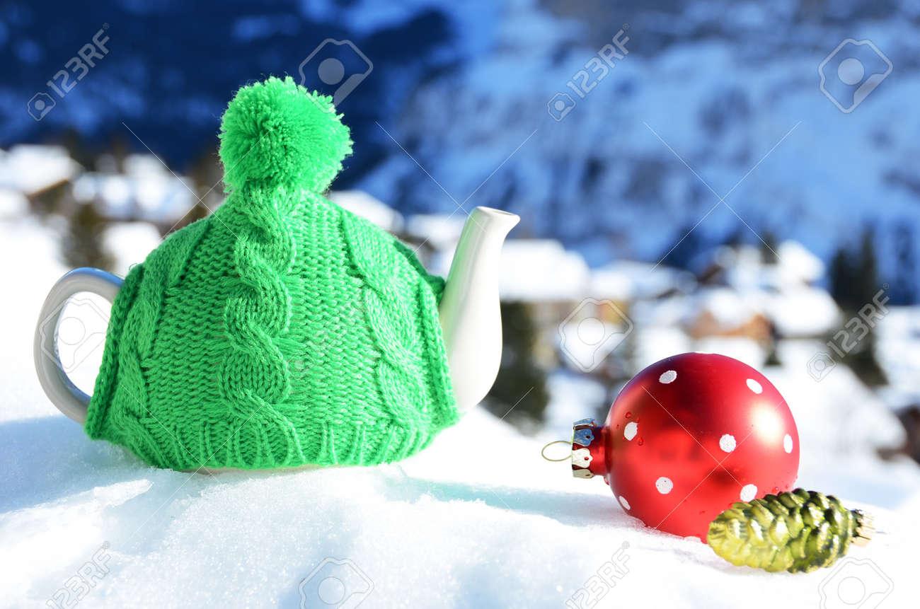 Tea pot in the cap against alpine scenery Stock Photo - 16829667