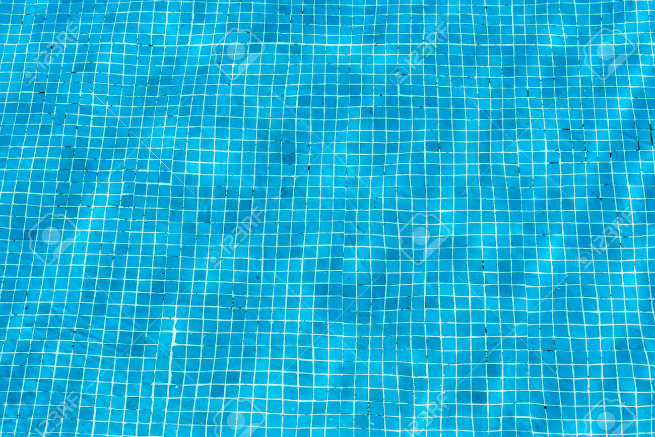 Turquoise blue swimming pool mosaic pattern on the floor of a..