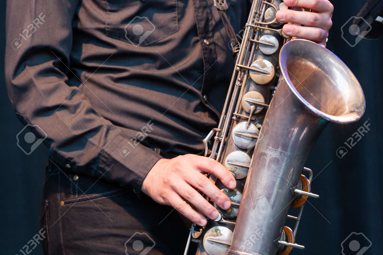 Close up view of the hands of a male saxophonist playing a tenor