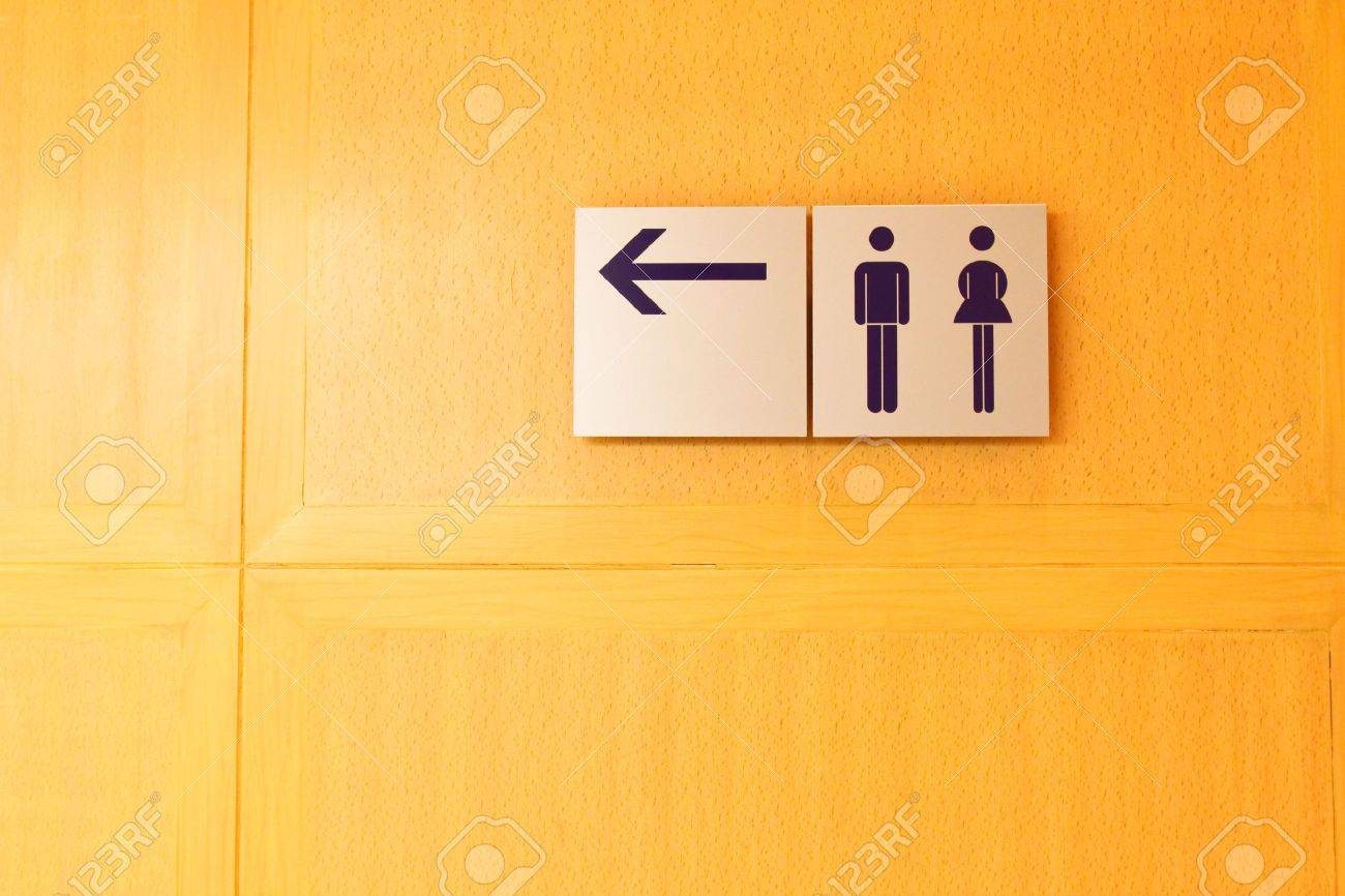 Yellow Bathroom Signs male and female bathroom sign stock photos & pictures. royalty