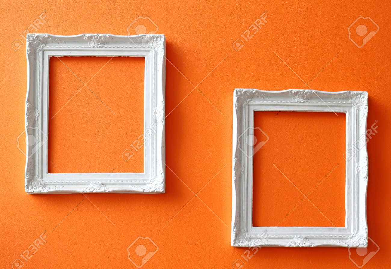 two white vintage frames on orange wall stock photo 9295754 - White Vintage Picture Frames