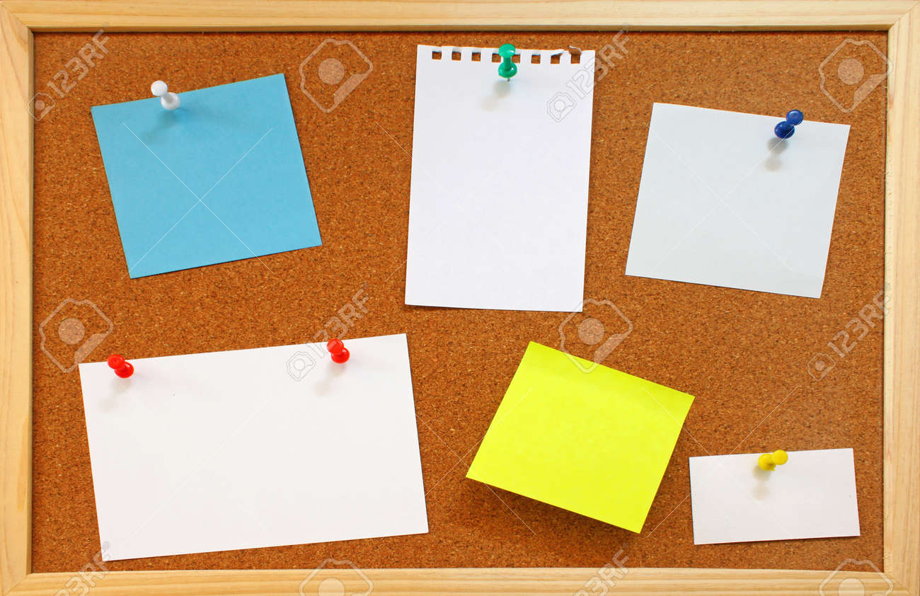 blank notes with colorful push pins on framed cork board stock photo - Framed Cork Board