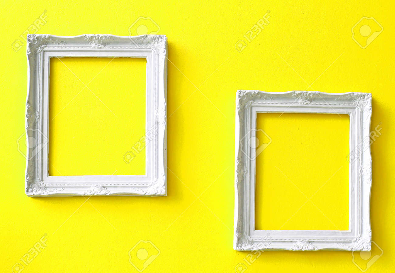 Two White Vintage Frames On Yellow Wall Stock Photo, Picture And ...