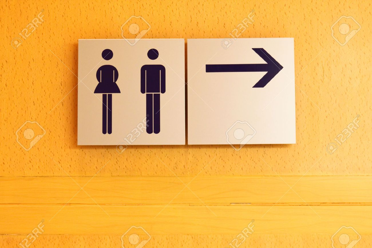 Toilet sign and direction on wood wall Stock Photo - 12770719