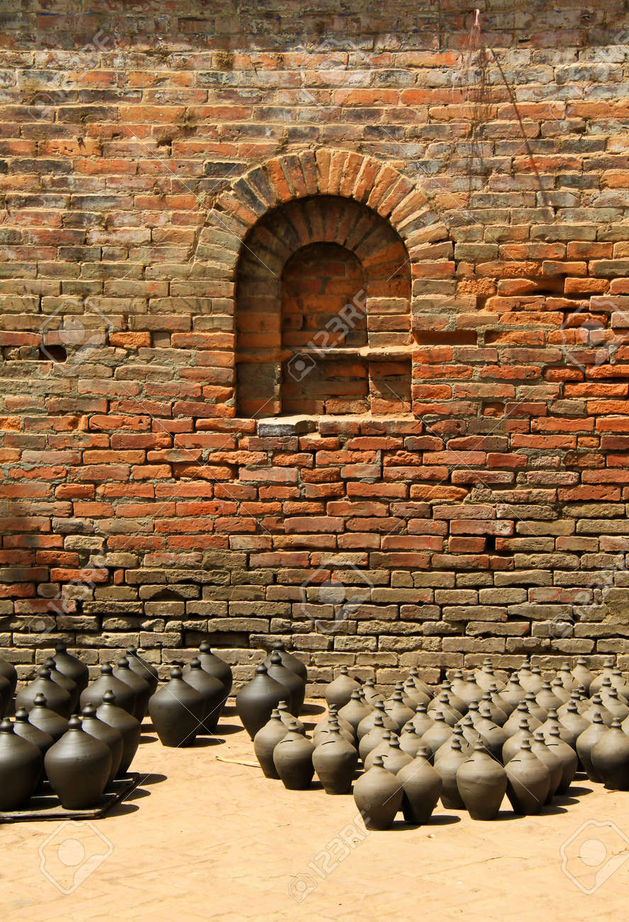 Many clay vases kept for drying with brick wall Stock Photo - 13178359