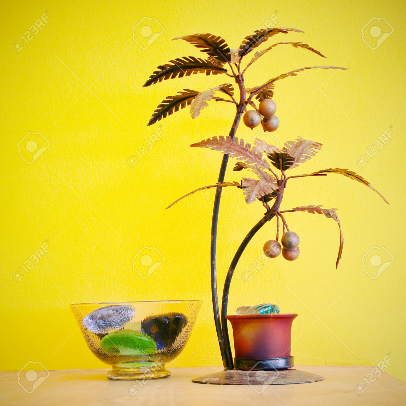 Decorative Tree And Yellow Wall With Reto Filter Effect Stock Photo ...