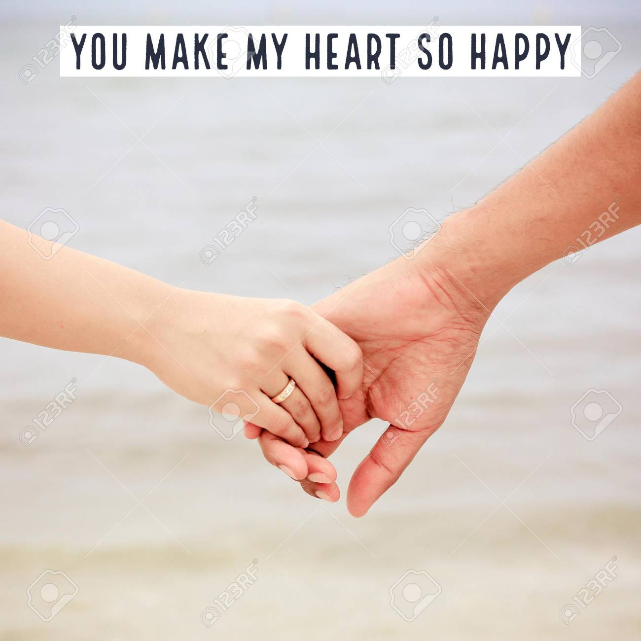 Inspirational motivation quote about love on couple holding hands