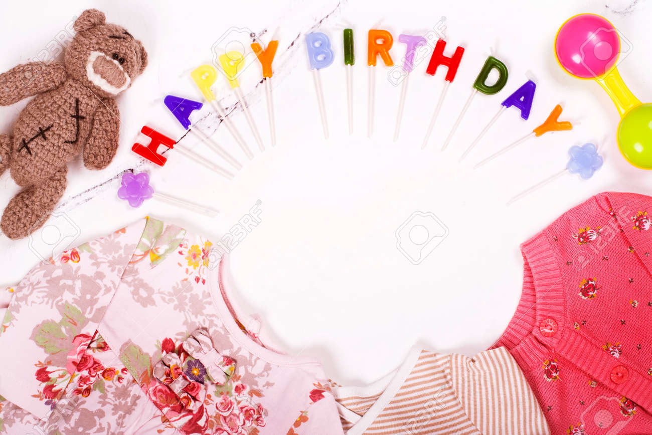 First Birthday Background Babys Clothes Toy Colorful Candles Stock Photo