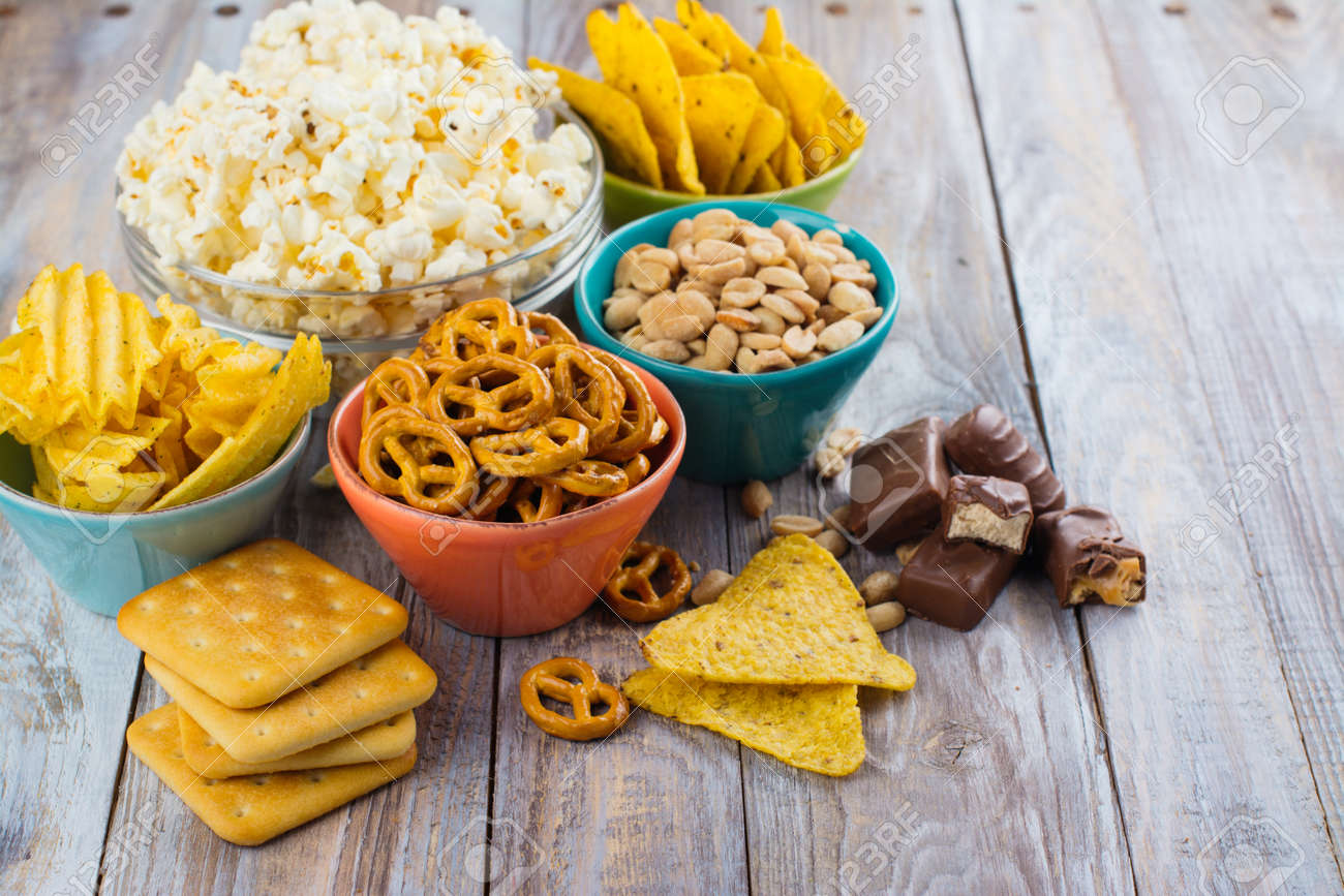 Assortment of unhealthy snacks. Diet or weight control concept. Space for text - 77354356