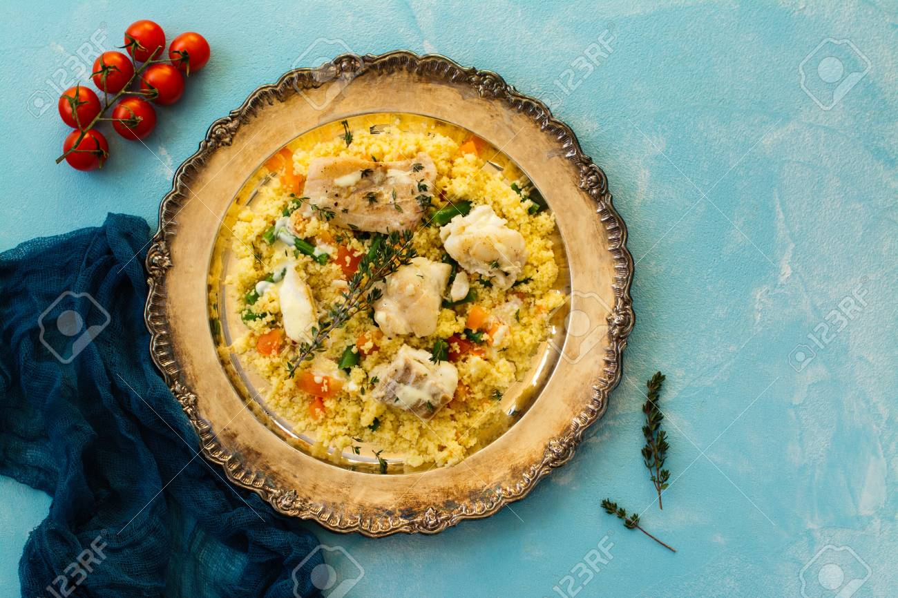 Couscous with fish and vegetables - 77378837