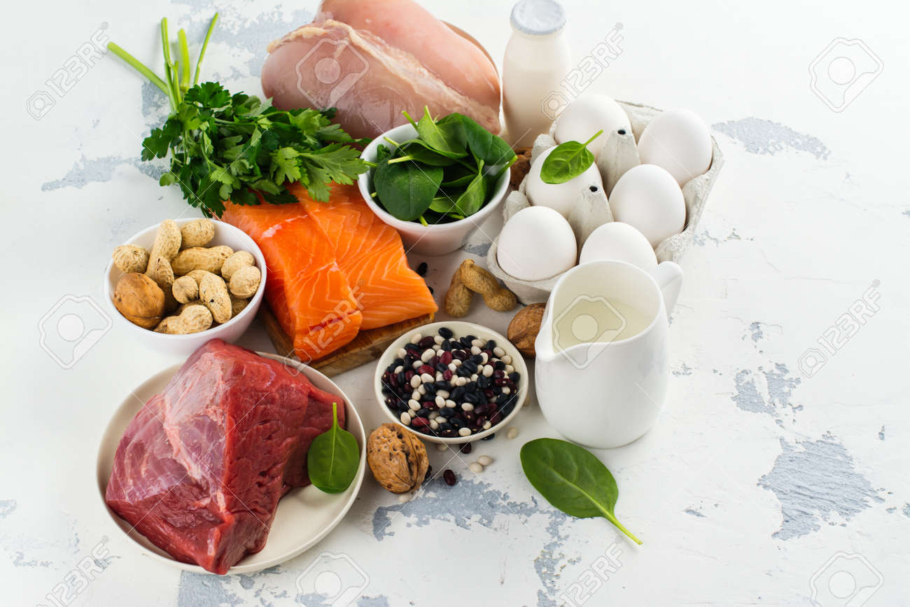 High protein food - fish, meat, poultry, nuts, eggs. Products good for healthy hair. Space for text - 85458682