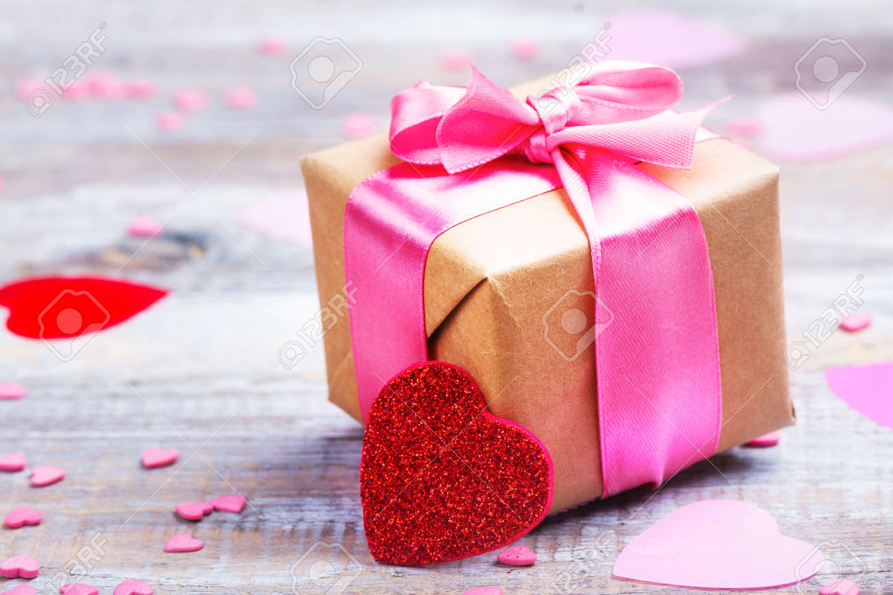 Gift Box With Pink Bow Ribbon And Glitter Hearts On Wooden Rustic ...