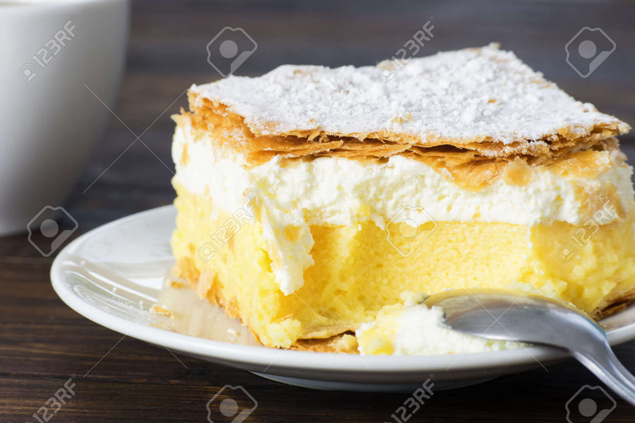 Close Up Of Vanilla Pudding Cake On Wooden Table Stock Photo