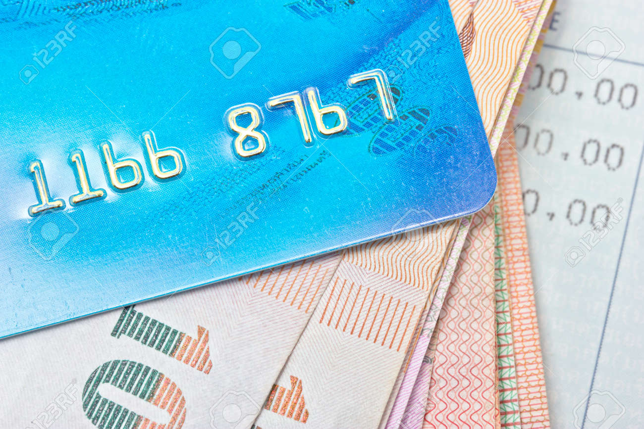 Credit card, Thai bank notes with bankbook Stock Photo - 19219565
