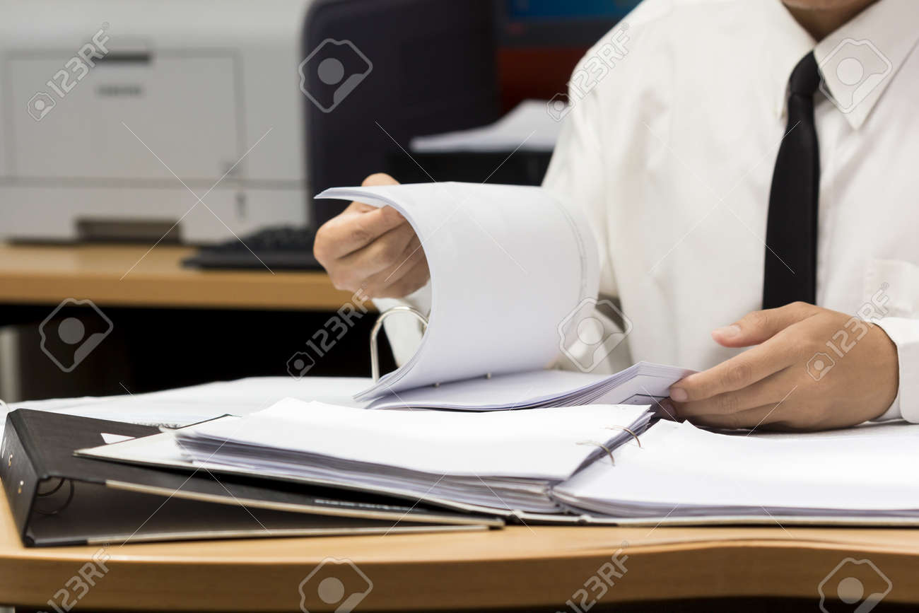 businessman search paper from file Stock Photo - 19158098