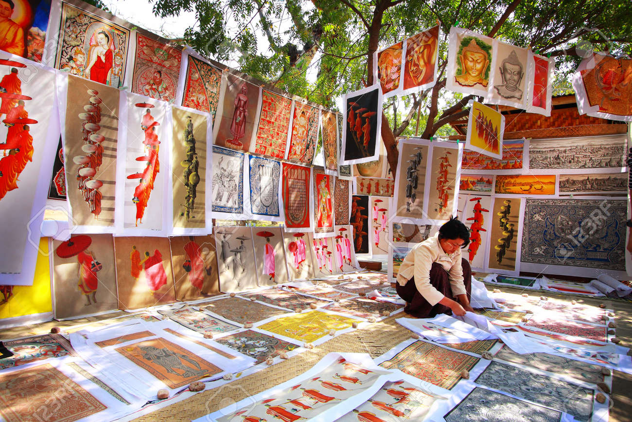 BAGAN, MYANMAR - FEBRUARY 15: Sand paintings for sale on February 15, 2011 in Bagan, Myanmar. Sand paintings are popular because they are made using sand-covered cloth as a medium rather than ordinary canvas - 27001389