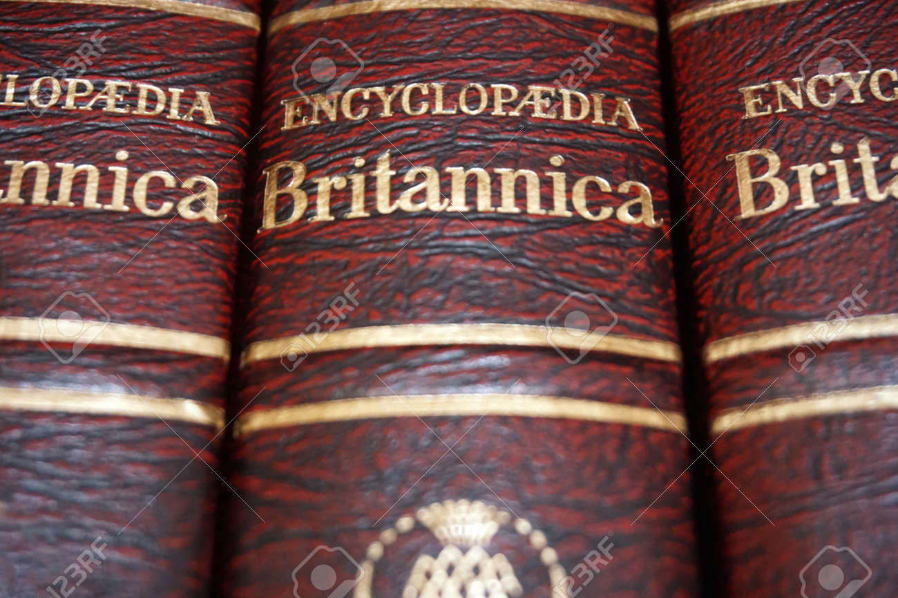 Rijeka, Croatia, September 25, 2018  Top view of volume encyclopedia  Britannica with title, close up view of red and gold cover