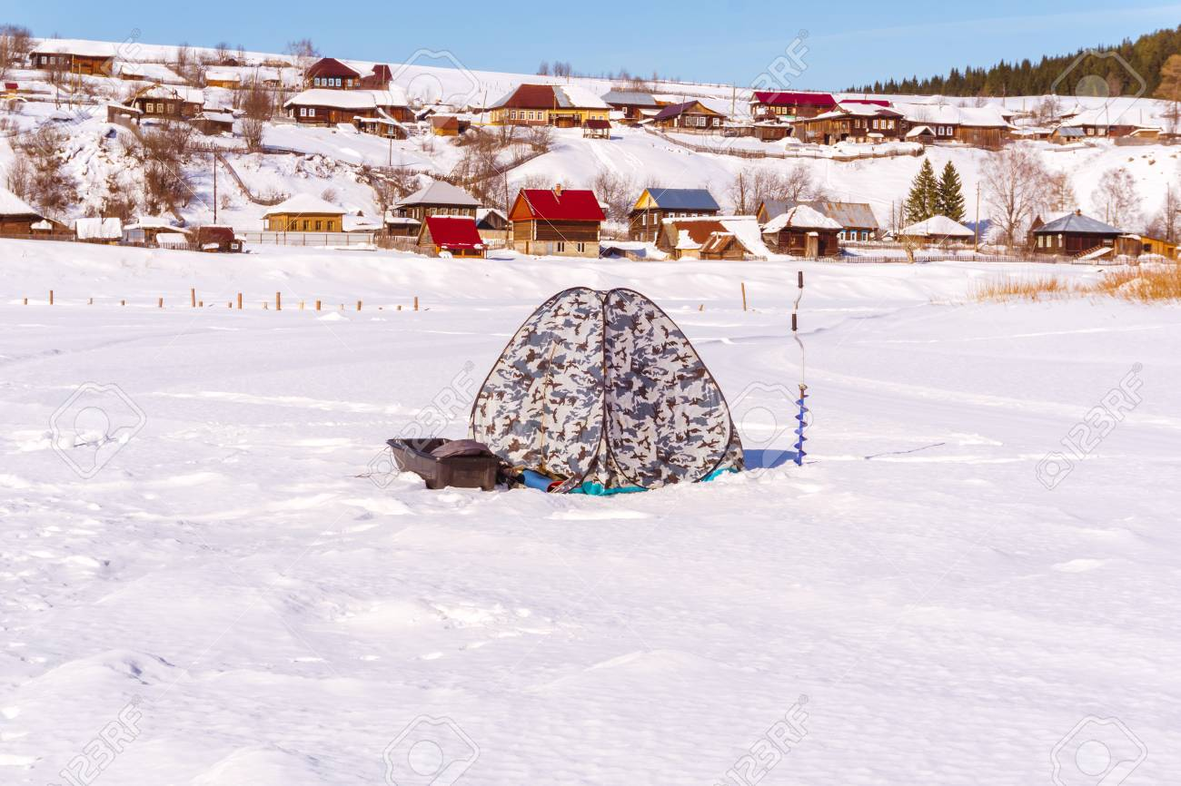 equipment for ice fishing - tent-shanty, hand auger and sleigh