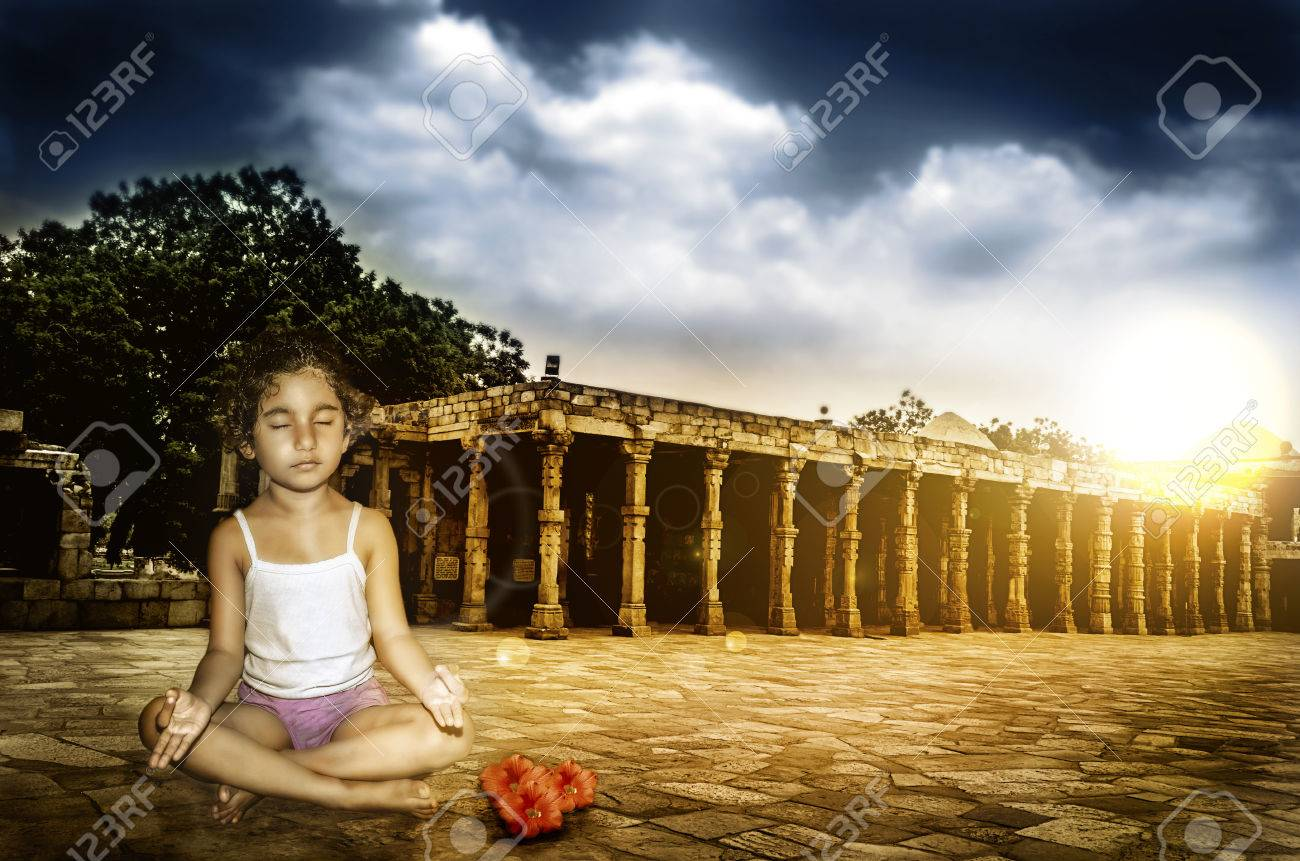 girl child meditating at sunset sunrise with dramaticl sky Stock Photo - 27486995