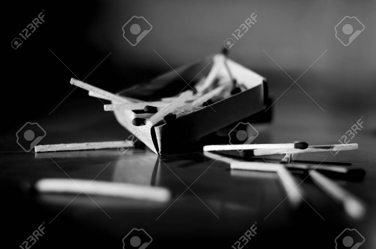 Match Box And Sticks Lying On Floor Macro Shot Indoor In Dark Depicting Concept Idea