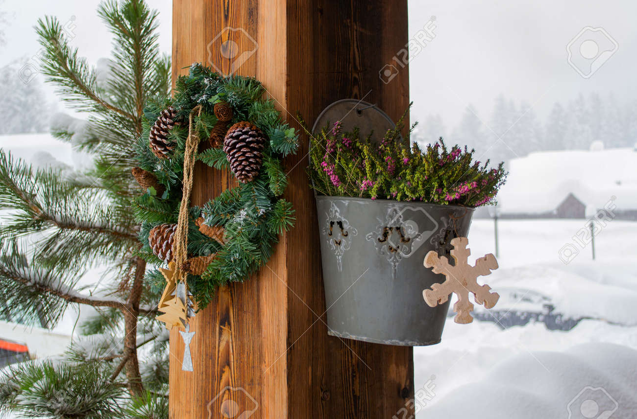 stock photo the rural house with christmas decorations on a wooden column