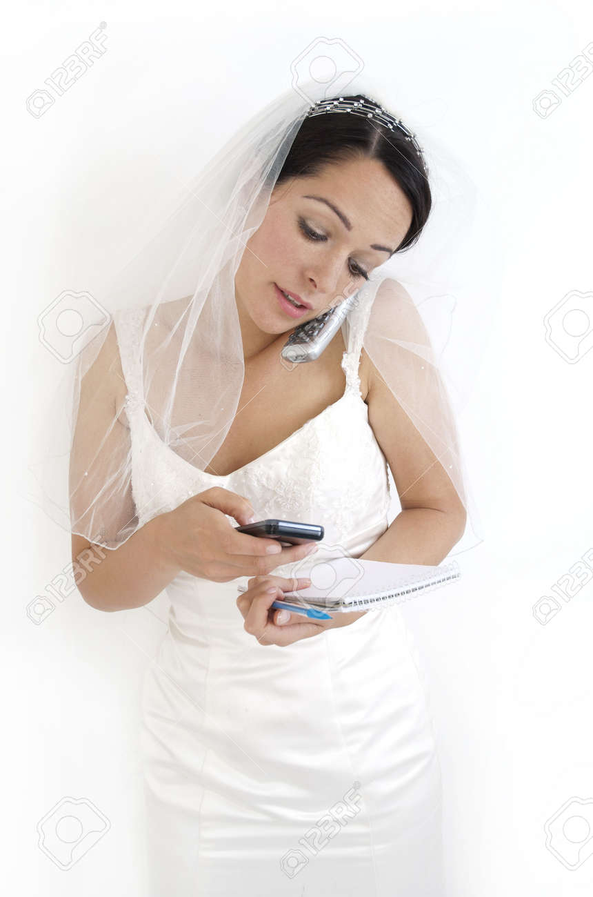 Planning The Wedding Holding Calculator Mobile Phone And Notepad Stock Photo Picture And Royalty Free Image Image 7463837