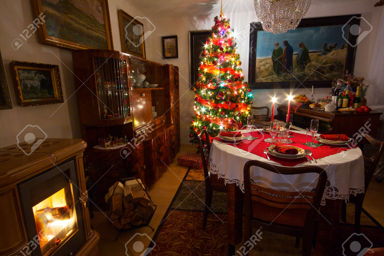 cozy room with decorated christmas tree old piano fireplace