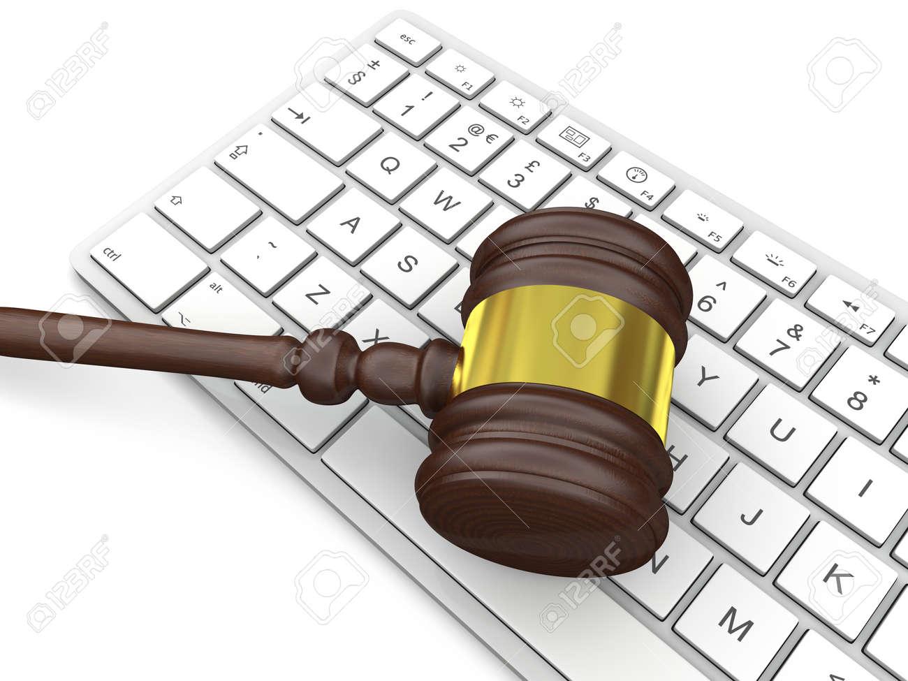 Wooden gavel on computer keyboard symbol of law and justice wooden gavel on computer keyboard symbol of law and justice in technology stock photo biocorpaavc
