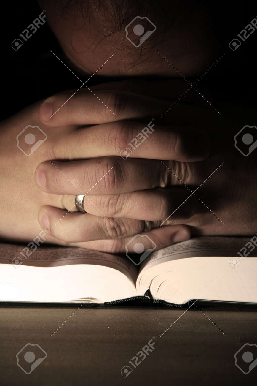 opened pages of a book on wooden table Stock Photo - 6088603
