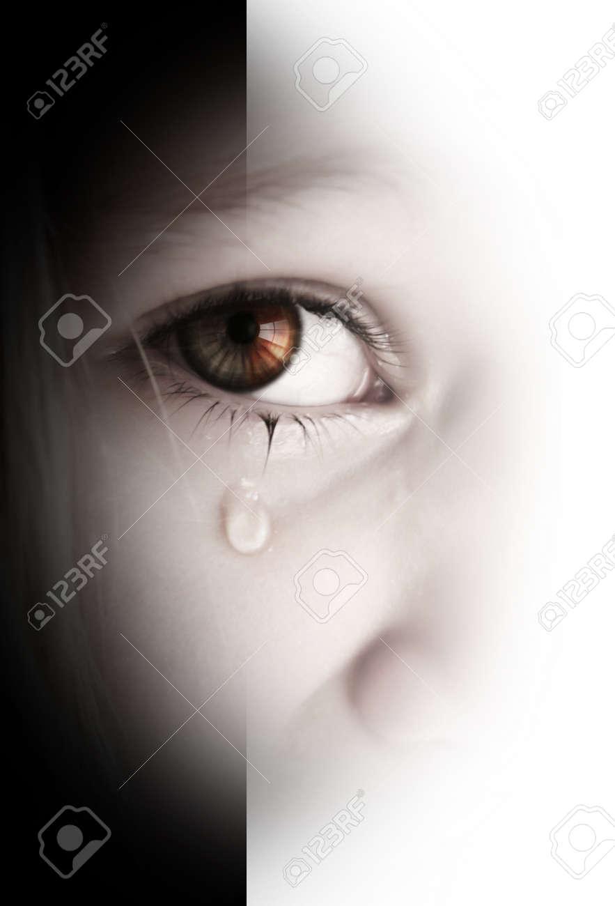 Little sad girl with tears in her eyes Standard-Bild - 9417629