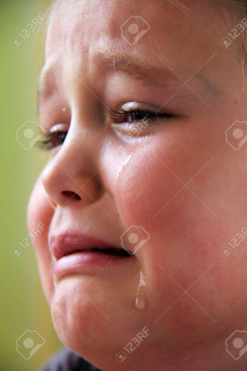 Little sad girl with teardrops in her eyes Stock Photo - 10667180
