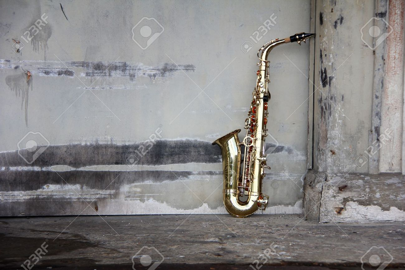 old grungy saxophone with old retro background - 10883202
