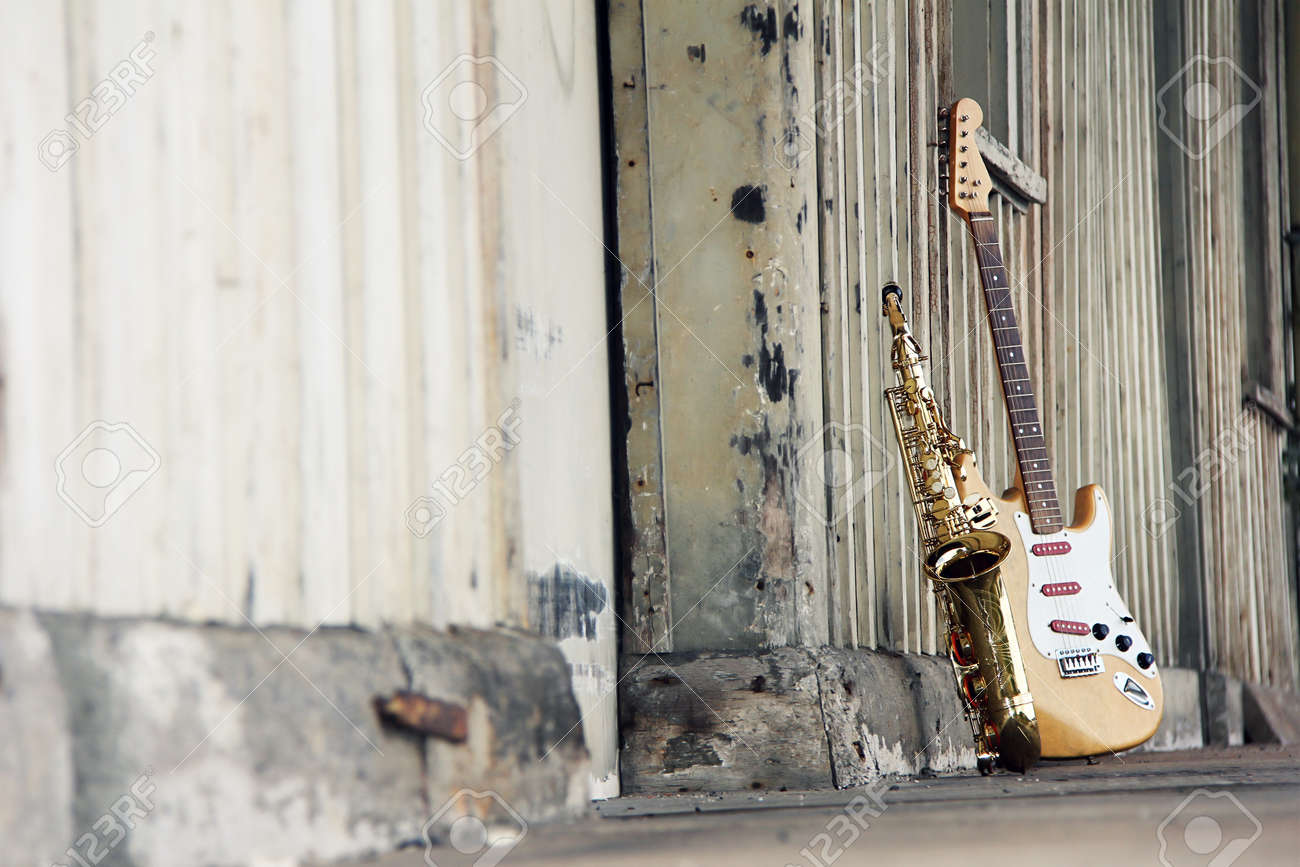 old grungy saxophone with old retro guitar Stock Photo - 11007472