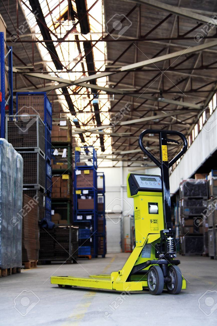 yellow pallet jack in the industrial warehouse Stock Photo - 15236877