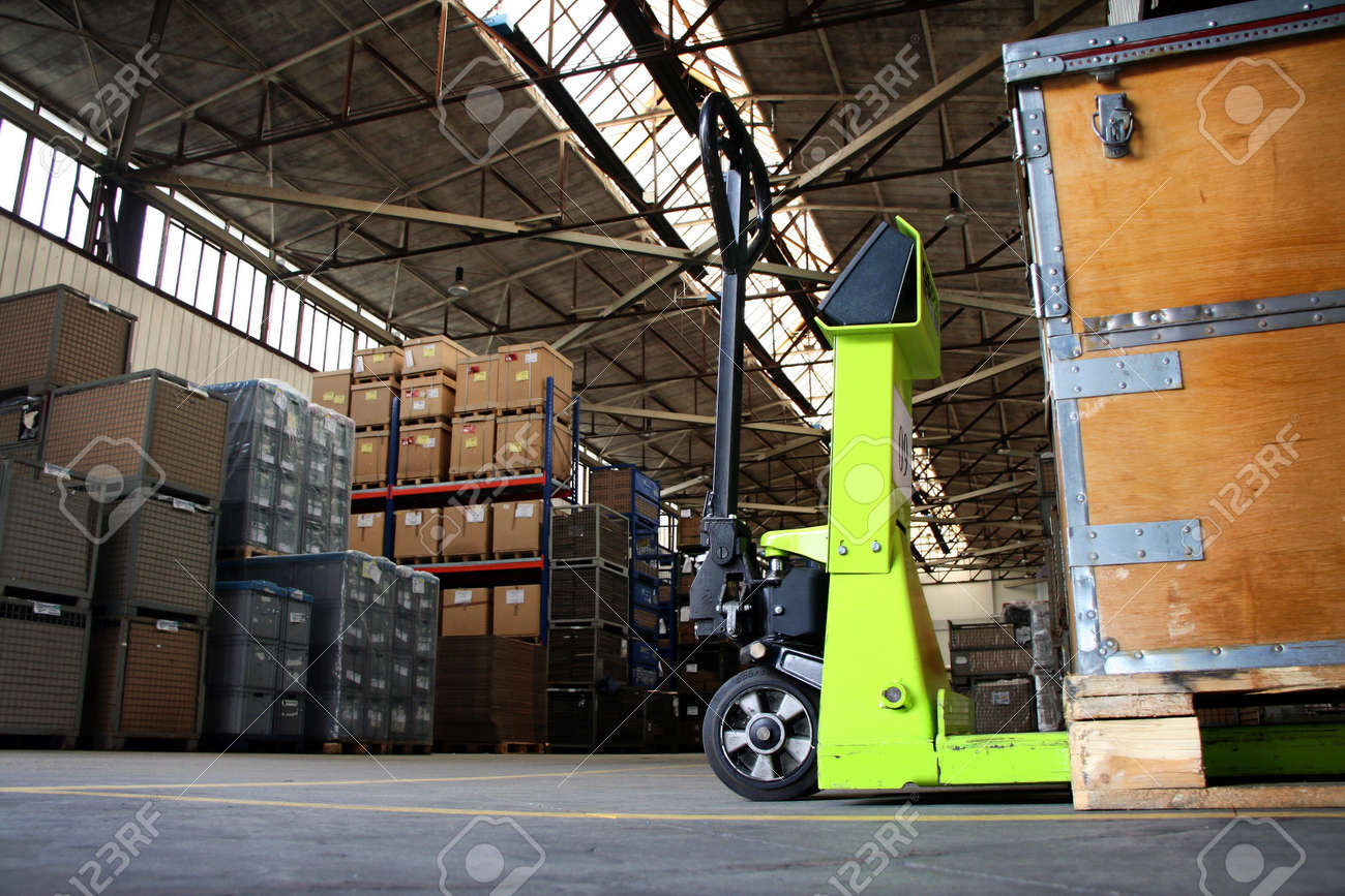 yellow pallet jack in the industrial warehouse Stock Photo - 15236881