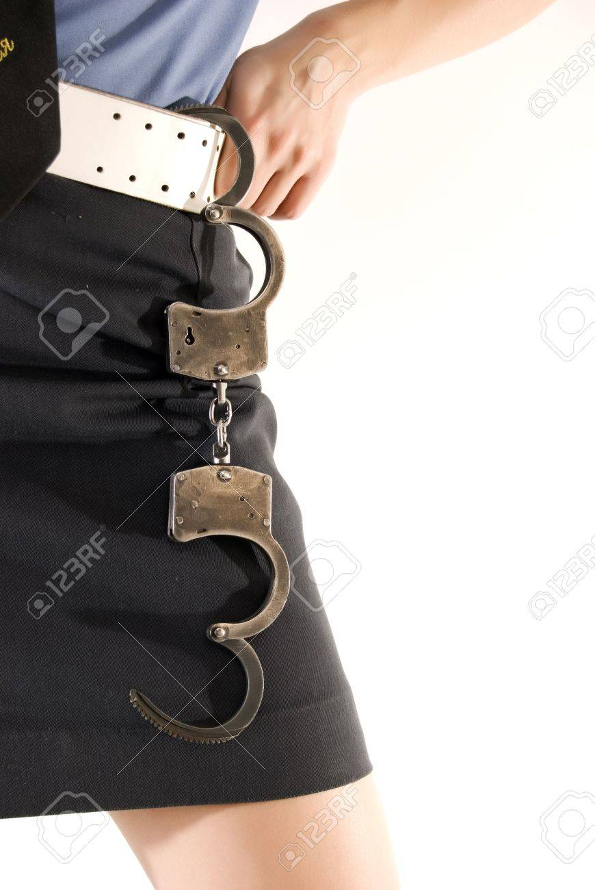 Young woman in police uniform holding handcuffs close-up Stock Photo - 8172624