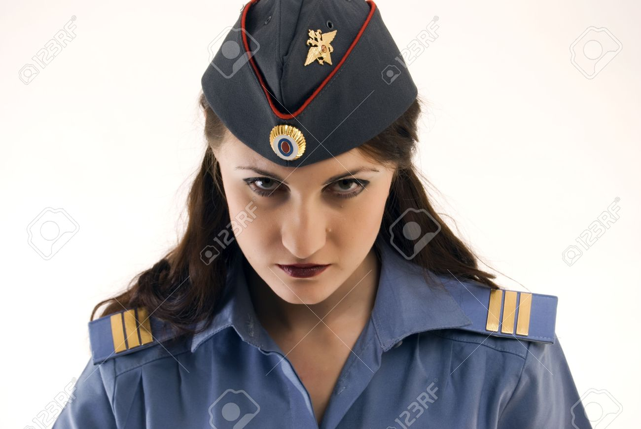 Young beautiful woman in police uniform being strict and serious Stock Photo - 8269733