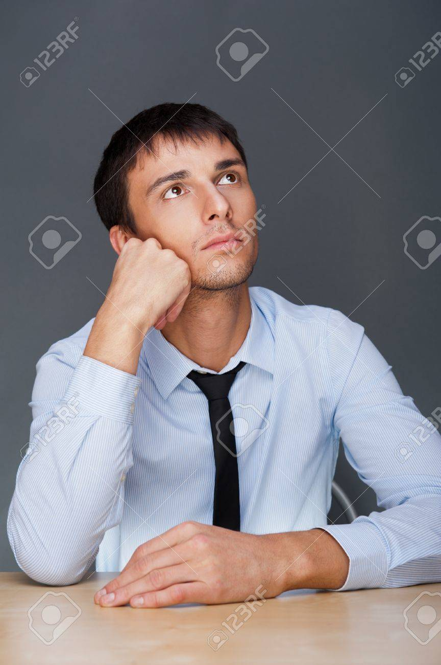 Portrait of an adult business man sitting in the office and daydreaming, planing Stock Photo - 27087472