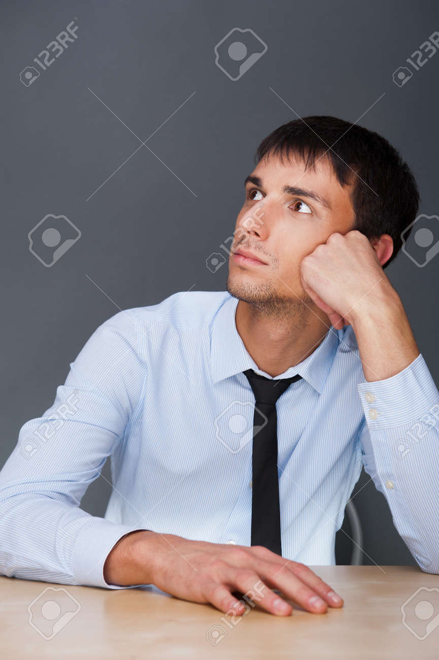 Portrait of an adult business man sitting in the office and daydreaming, planing Stock Photo - 27087475
