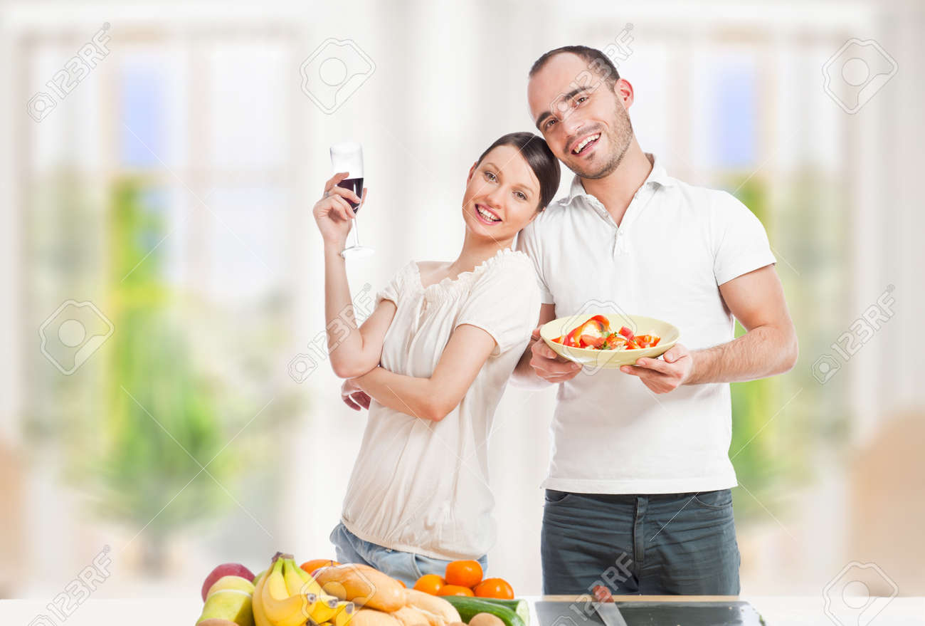 Lovely Romantic Couple In Casuals Enjoying A Goodtime In Kitchen ...