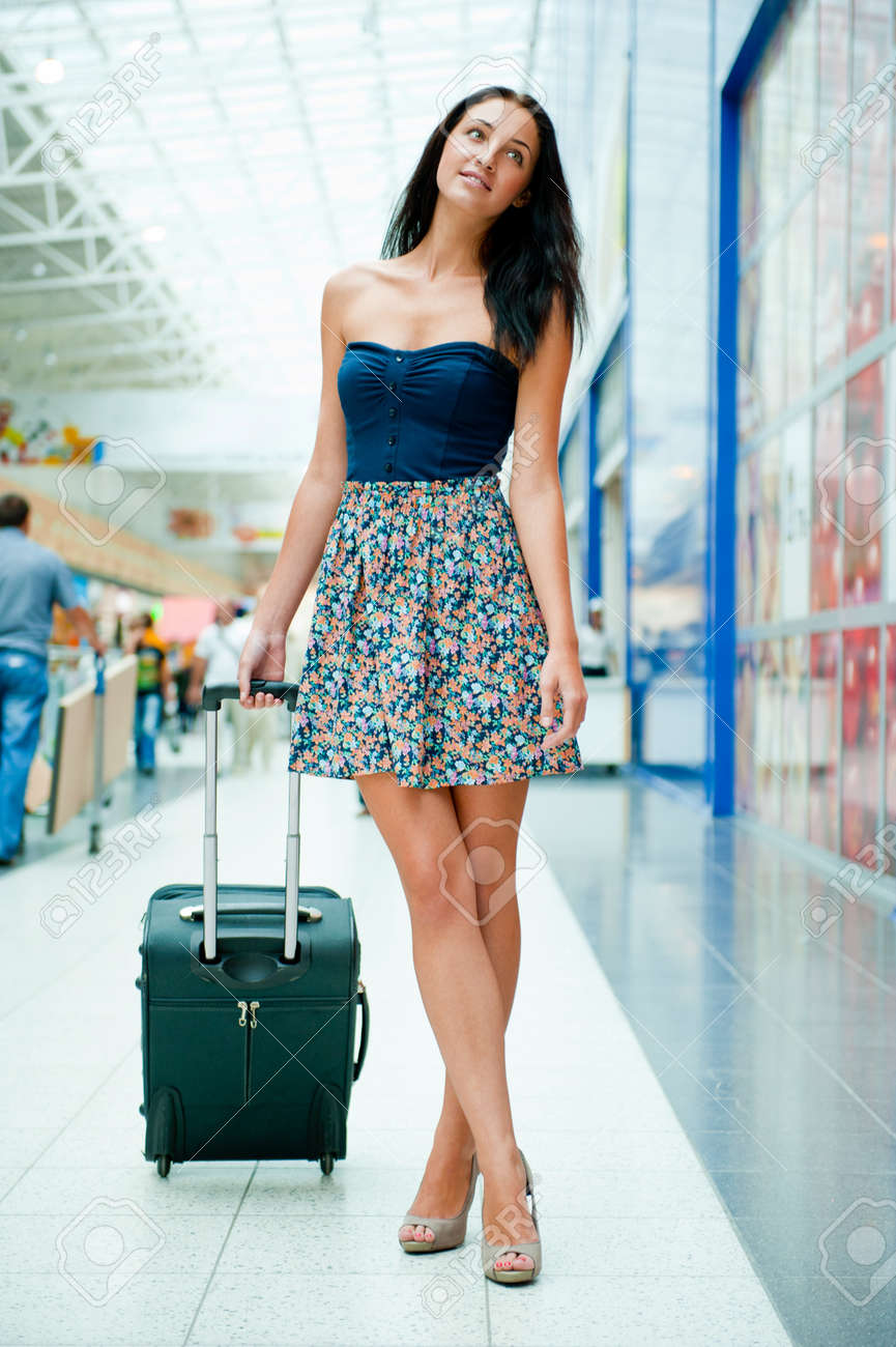 Young Pretty Stylish Woman With Luggage At The International ...